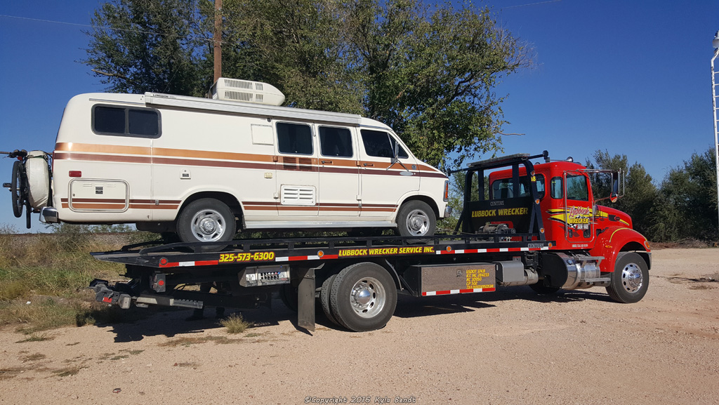 van-on-tow-truck