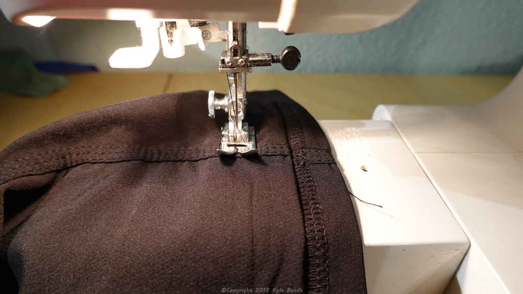 how to hem pants: step 5, option B.  Fold extra fabric up and secure with a few stitches