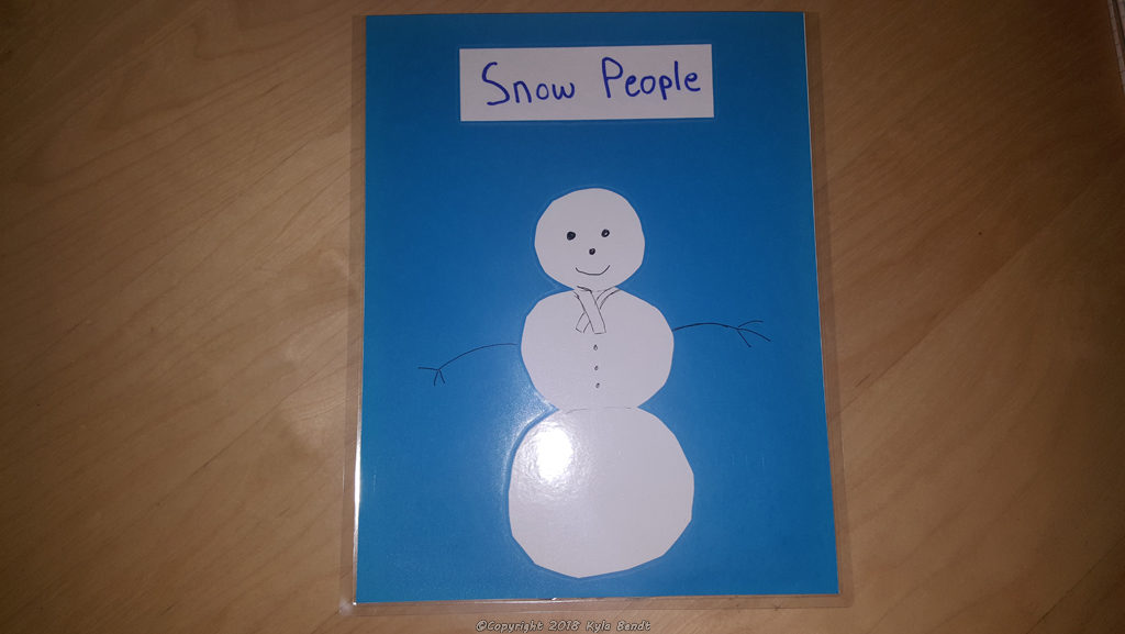 laminator project: laminated pouch for holding flat objects.  This one is blue, has a picture of a snowman and is labeled 'Snow People'