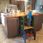 toddler on step stool