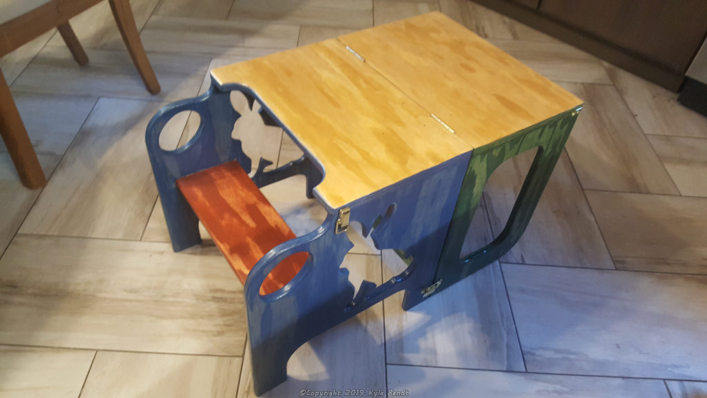 Convertible toddler step stool and table folded into table mode.