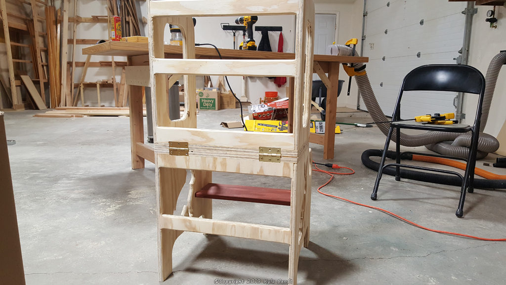Unfinished convertible kid's step stool and table in step stool mode.