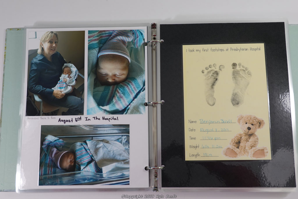 laminated baby book page - footprints from hospital and photos from hospital