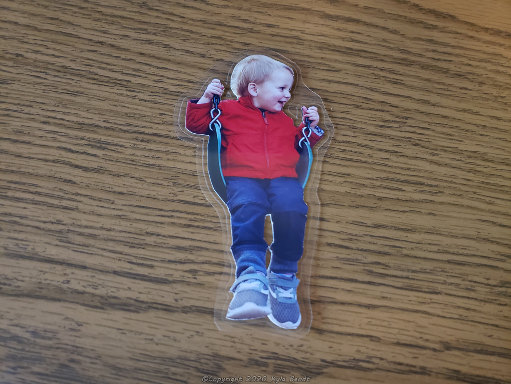 laminated child on swing image for making a christmas ornament